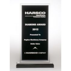 """Our Black Acrylic Award is 1/2"""" thick black pattern acrylic with a silver border.  A6761 is 7.5"""" tall and A6862 is 8.5"""" tall.  Each includes free personalized engraving."""