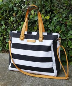 The Black & White Weekender Lux by White Elm is our most popular diaper bag. Use it to carry your breast pump, baby gear, cloth diapers, changing pad, etc. Teacher Tote Bags, Nurse Bag, Striped Tote Bags, Stylish Handbags, Carry All Bag, Laptop Bag, Weekender Tote, Diaper Bag, Travel Tote