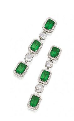 PAIR OF EMERALD AND DIAMOND EARRINGS.  The fringes set with 6 emerald-cut emeralds weighing approximately 9.50 carats, framed by small round diamonds and joined by 4 rose-cut diamonds, the total diamond weight approximately 4.25 carats, mounted in 18 karat white gold.