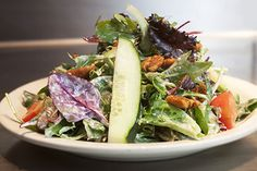 Fresh leaf salad with cucumbers, romas, spiced pecans and shallot vinaigrette