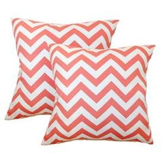 """Set of two cotton pillows with chevron motifs. Made in the USA.    Product: Set of 2 pillowsConstruction Material: Cotton cover and 95/5 down fillColor: Coral and whiteFeatures:  Inserts includedHidden zipper closureMade in the USA Dimensions: 18"""" x 18"""" eachCleaning and Care: Spot clean"""