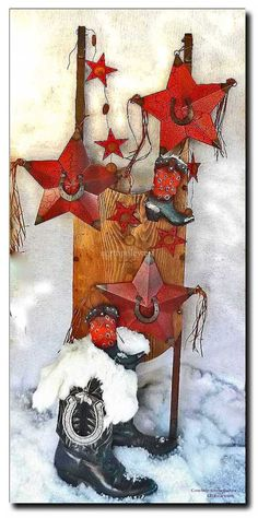Cowboy Christmas boots,stars and horseshoe western ornaments on sled picture by LB Entrekin