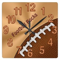 "Customizable Cool Football Clocks for Guys.  Change ""Football Rocks"" to the football player's or coach's NAME, Team NAME or any text you like. Highlight the text and Type YOUR TEXT or DELETE. Football Clocks make great Football Team Gifts, Christmas Gifts and any special occasion. Cool gold, copper and textured football for the personalized football gifts for guys bedroom. Kids to Teenagers to Men will be proud to show off this cool personalized clock.  <br> <br> See lots of coordinating…"