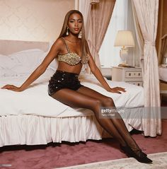 British supermodel Naomi Campbell, wearing a pearl encrusted bra top, posing in a hotel room in New York, August 1991.