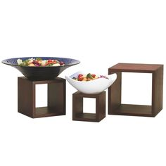 "Use these American Metalcraft RSM2 mahogany wood risers to elegantly elevate platters of your signature specialties! Made from classic mahogany wood, these 3 square risers complement any restaurant or buffet's decor. Whether you're creating an eye-catching tabletop display or showcasing bowls of fresh fruit and vegetables, these risers are up for the task. <br><br> <b><u>Includes:</b></u><br> (1) 5"" x 5"" riser<br> (1) 7"" x 7"" riser<br> (1) 9"" x 9"" riser"