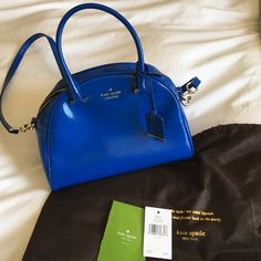 Kate Spade Cedar Street Orbit Blue Purse Kate Spade Cedar Street Patent Small Pearl Orbit Blue Purse - $298. A couple small pink marks inside, otherwise perfect.  Used three times.  Dust Bag included kate spade Bags