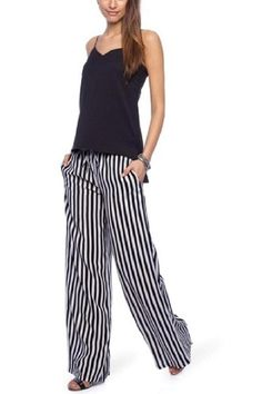 Verona Pants by Pink Stitch. Features a relaxed and flowy fit, the Pink Stitch Verona Pants offers a stylishly comfy vibe. Wide-leg cut. Drawstring, ribbed waistband. Twin hip pockets. Monochrome, vertical stripe design   Verona Pants by Pink Stitch. Clothing - Bottoms - Pants & Leggings Miami, Florida