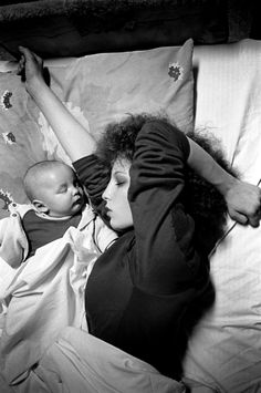 "© Donna Ferrato - 1st Safe Nite...A mother and her infant son slept peacefully after arriving at the Women Against Abuse shelter. The next morning she said, ""It was our first safe night in a long, long time."""
