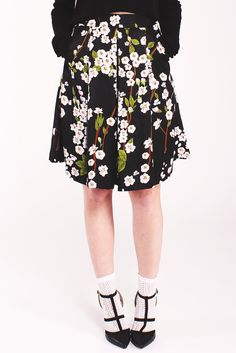 Louche Ritz Blossom Skirt. Lightweight Black skirt. Floral pattern. Inverted pleats. Midi length.