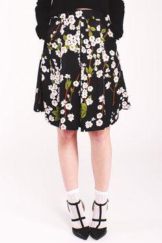 Louche Ritz Blossom Skirt. Lightweight Black skirt. Floral pattern. Inverted pleats. Midi length.