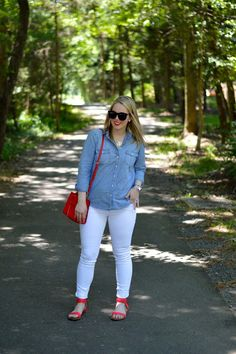Chambray top with white jeans and red accessories.