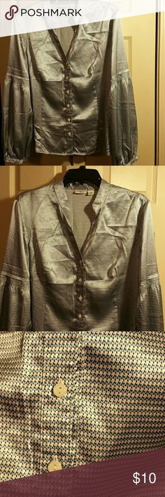 Button down top. Great for the office. Pretty patterned top. Colors are white with small blue and black patterns. Slight elastic gathering above the elbows. In perfect condition. Just wrinkled from hanging in the closet. Cato Tops