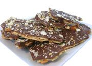 """Sweet and Salty Saltine Toffee - Super easy for the """"can't ever stop eating!"""" taste. Increase the """"toffee"""" (2-3 more tbs of butter and eyeball the brown sugar) and stick with semi-sweet chocolate (I experimented with dark, not bad, but not as good)"""