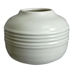 """This elegant Art Deco vase – a hard to find shape originally from the 1920's """"Rosecraft"""" line - features a squat vessel accented with a ribbed center """"belt"""", covered in a creamy ivory semi-matte glaze. Roseville Pottery Ivory Vase #585-4"""", """"Rosecraft"""" Shape, Circa 1932"""