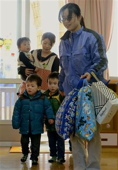Small children arrive at a nursery school in Tamura, Fukushima Prefecture, northeastern Japan, Tuesday, April 1, 2014 after authorities allowed residents to return to live in their homes within a tiny part of a 20-kilometer (12-mile) evacuation zone around the Fukushima ... (AP Photo/Kyodo News) JAPAN OUT, MANDATORY CREDIT ▼1Apr2014AP|Japan lets first evacuees live in nuke no-go zone http://bigstory.ap.org/article/japan-allows-some-evacuees-back-nuke-no-go-zone #Fukushima #Tohoku2011 #Japan