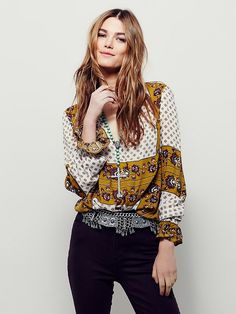 Border Print Collar Tunic   Effortless and oversized lightweight printed tunic featuring a deep V neckline and collar detail.  Side vents and a rounded hem.  Elastic band on the wrists with a flared cuff.