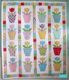 Tulip Pots Quilt 66 x 78 Tulip Pillows Listing is for pattern only. This pattern uses the Bee in my Bonnet Thimble Rulers. Quilt Baby, Scrappy Quilts, Mini Quilts, Quilting Projects, Quilting Designs, Quilt Modernen, Bee In My Bonnet, Flower Quilts, Basket Quilt