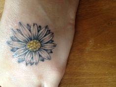 My daisy tattoo for my mom & grandma