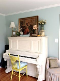 Another painted piano. Love the white with the pop of color on the chair!