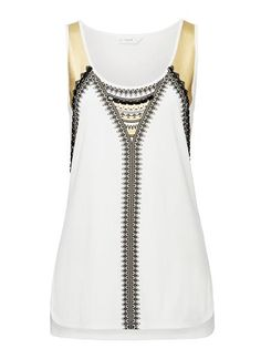 Seed Cotton/Modal Aztec Beaded Tank. Comfortable swing fit. Features a front aztec placement print and beading. Available in Cream.