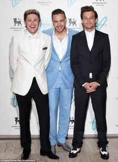 You can tell Lou said something hilarious and is trying to contain his laughter. Niall and Liam also give the hint cause they burst out laughing