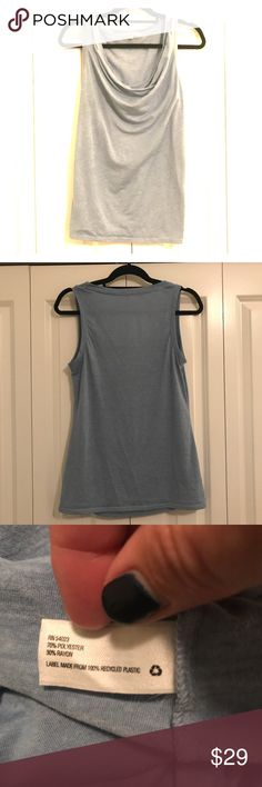 GAP blue T-shirt material sleeveless T-shirt Beautiful bright blue T-shirt material GAP sleeveless dress shirt with cowl neck. Can be dressed up and so classy. Double lined in the front (double layered). Great white stitching. Have dry cleaned and kept in a smoke free/pet free home. In perfect condition. Love this piece as it looks classy but is comfortable and I don't need a bra under it. Looks great at work or with jeans for a night out. Can be worn with flip flops and causal. Super…