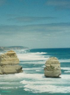 Two of the 'Twelve Apostles', along the Great Ocean Road, VIC. Sadly today, there are only 8 of the 'stacks' left due to the erosion. As the headlands are being worn away, in the future, their remains will create new stacks. (This photo was taken in 1995) photo©jadoretotravel