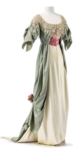 """europeanafashion: """" Evening dress by Jeanne Paquin, spring/summer collection, Paris, This dress in pastel shades combines a tunique in light green silk in tabby weave with a skirt made of cream silk satin. The rose red corset belt accentuates. Edwardian Clothing, Edwardian Dress, Antique Clothing, Edwardian Fashion, Historical Clothing, Edwardian Era, Victorian, Historical Dress, Vintage Fashion"""