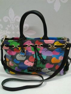 """Brand:Dooney & Bourke  Size  M Measuring 7 1/2"""" H X 5 1/2"""" D X 10 1/2"""" L Strap Drop: 4 1/2"""" Detachable shoulder strap 19"""" L  Color:Multi-color/Black  Material: All weather Leather/Cowhide leather  Style # ND45 BB Tassel tote 87144990/ Serial # B7159297  Condition:Pre-owned item, excellent condition. Normal wear on front of bag and a small interior light stain on corner. Overall clean and leather looks like new. A- Condition."""