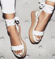 A pair of white strappy espadrille so you can wear them in summer *and* fall
