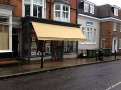 Colour coded wood work to match the shop front by Deans Blinds & Awnings