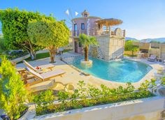 Holiday villa rental in Chania. Villa Sorokos with private swimming pool. The windmill consists of ground floor and first floor. Luxury Holidays, Crete, Windmill, Ground Floor, Villas, Swimming Pools, Mansions, House Styles, Outdoor Decor