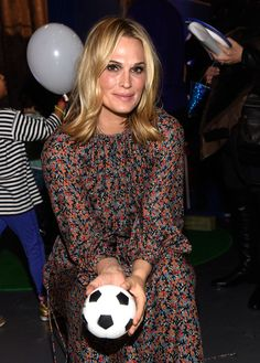 Molly Sims attends the 'A Real Curious World' app launch event at The Intrepid Museum with her family.