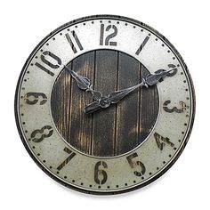 This 20 rustic punch-work clock has the feel of an old-time farmhouse or general store. It's made from metal, wood and MDF, and features Arabic cut-out numerals over a plank-like face.