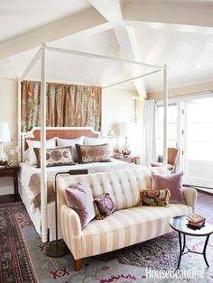 Settee in Master Bedroom, Four Poster Bed, gorgeous area rug. Peter Dunham, House Beautiful