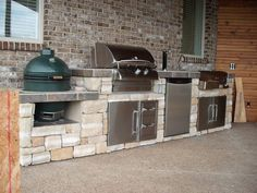 Gas grill, smoker, charcoal grill, this one does it all and looks good too. Let Best in Backyards help you create the ultimate backyard experience with a custom kitchen island. Select all of the components that you would like to feature from our wide arr Outdoor Kitchen Patio, Outdoor Kitchen Countertops, Outdoor Kitchen Design, Outdoor Living, Outdoor Kitchens, Big Green Egg Outdoor Kitchen, Kitchen Rustic, Quartz Countertops, Grill Bar