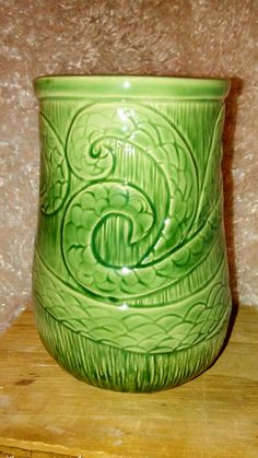 Pottery by Jackque Kahn. Wheel thrown, hand carved, glazed with Amaco potters choice dark green
