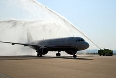 Charter flight # 9090 is greeted with a water cannon salute as it enters the US Airways ramp
