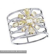 Stunning white and yellow Diamonds cuff by William Goldberg