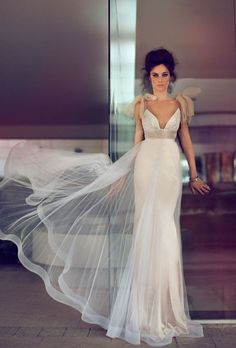 I know it's a wedding dress but I just love it.  Would be stunning in black as an evening dress.......