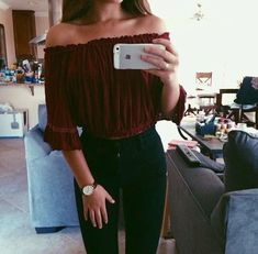 Cute burgundy off the shoulder top with black pants.