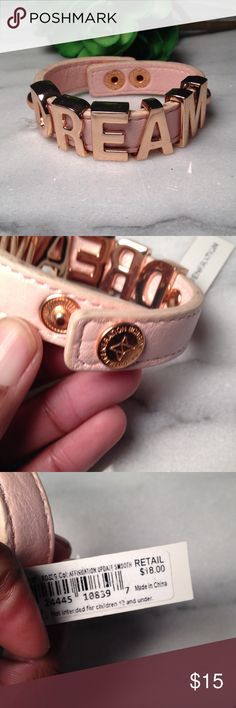BCBGeneration Bracelet BCBGeneration Bracelet. Rose gold letters and a pink strap that closes with a snap at the end. Slight scuff mark on the edge shown in the last picture. Great piece for your wrist candy! BCBGeneration Jewelry Bracelets