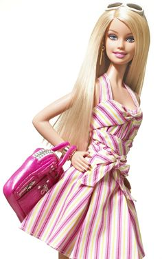 I never owned a Barbie doll my entire childhood. My mother was against them, which made me want them more.