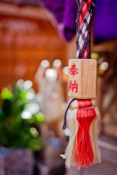 A prayer rope, attached to a bell which is rung to get the attention of the gods before prayer inside Tatsumi Daimyoji on Shirakawa Minami Dori in Kyoto's Gion geisha district, Japan.