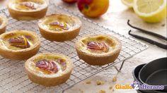 Ricetta Tartellette alle pesche e crema - Le Ricette di GialloZafferano.it