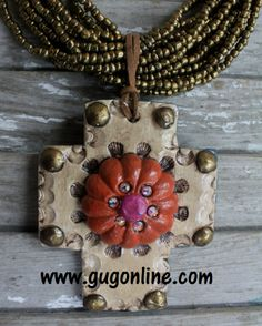 Odessa in Cream, Rust, and Teal Cross Pendant $39.95 www.gugonline.com