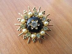 Vintage starburst rhinestone and pearl brooch signed by lolatrail