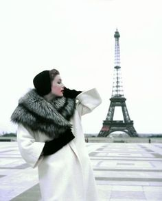 Suzy Parker at the Eiffel Tower wearing a winter ensemble by Givenchy in a 1954 photo by Georges Dambier for ELLE
