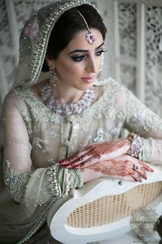 My goodness this is beautiful!!! A lovely off white bridal gown with beautiful floral design jewelry! Desi Wedding