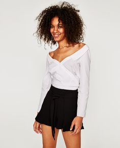 Image 1 of FLOWING BERMUDA SHORTS WITH RUFFLED HEMS from Zara